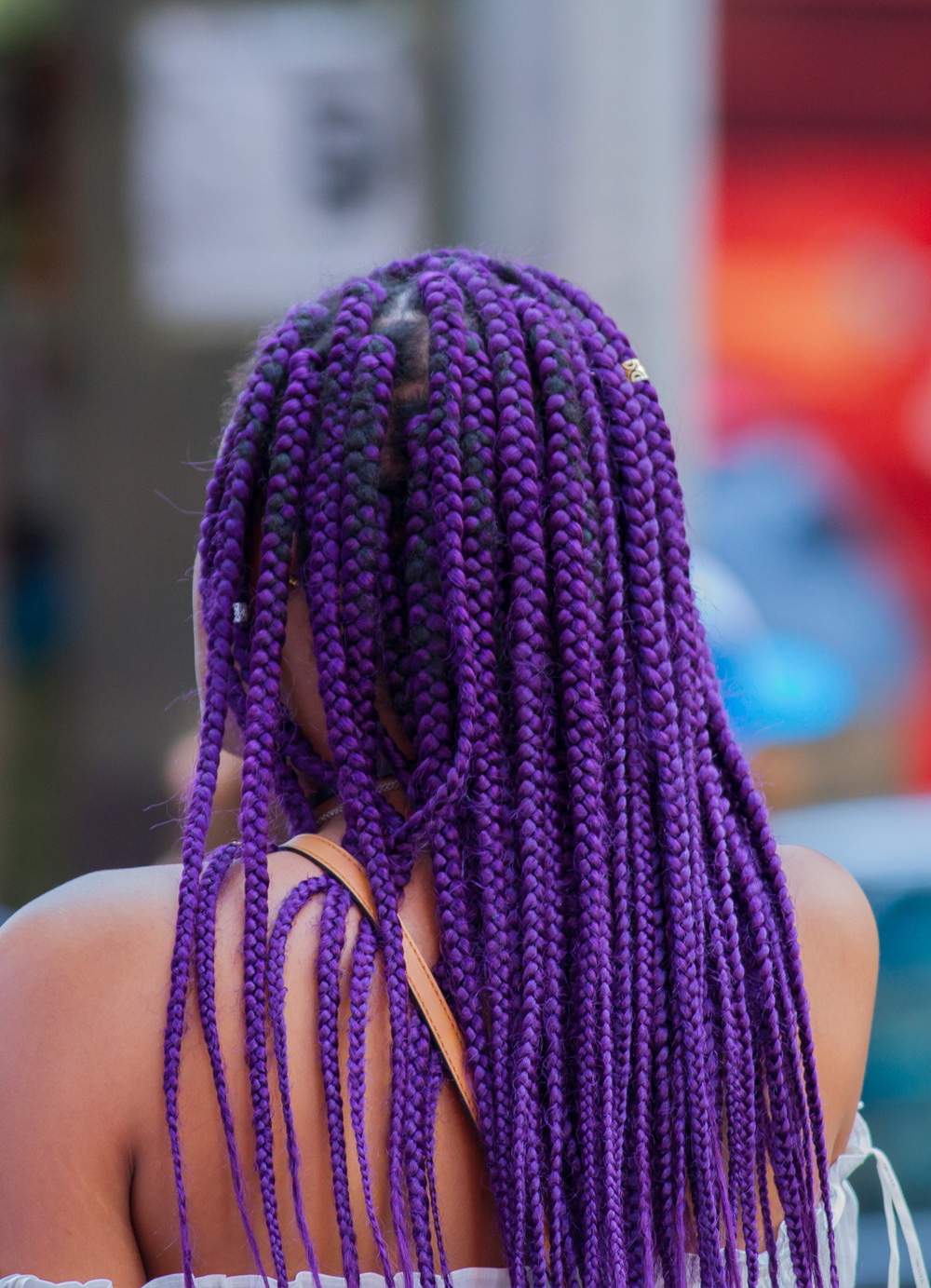 colorful real-life photo of a beautiful wife with purple hairs photographed from behind