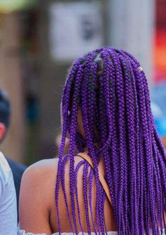 beautiful wife with ultra violet hairs photographed from behind
