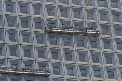 window cleaning at height, example of a real-world stock photo with geometric shapes