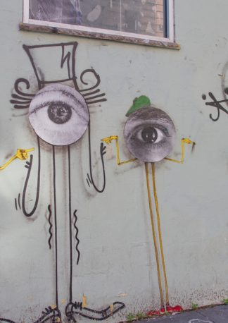 graffiti collage, three eye-creatures with caps in red and green, one graffiti artist