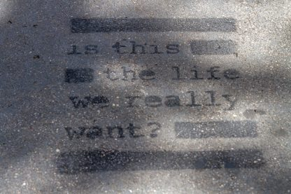is this the life we really want, printed on ground, typewriter font