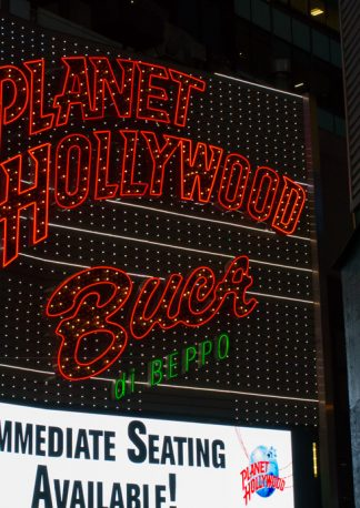 slightly curved lettering of the planet hollywood neon light