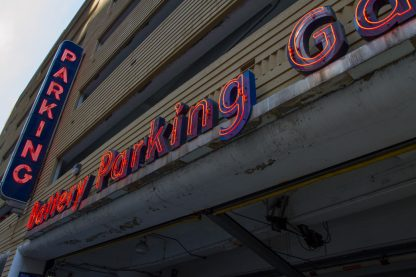 interesting perspective of a red parking neon sign